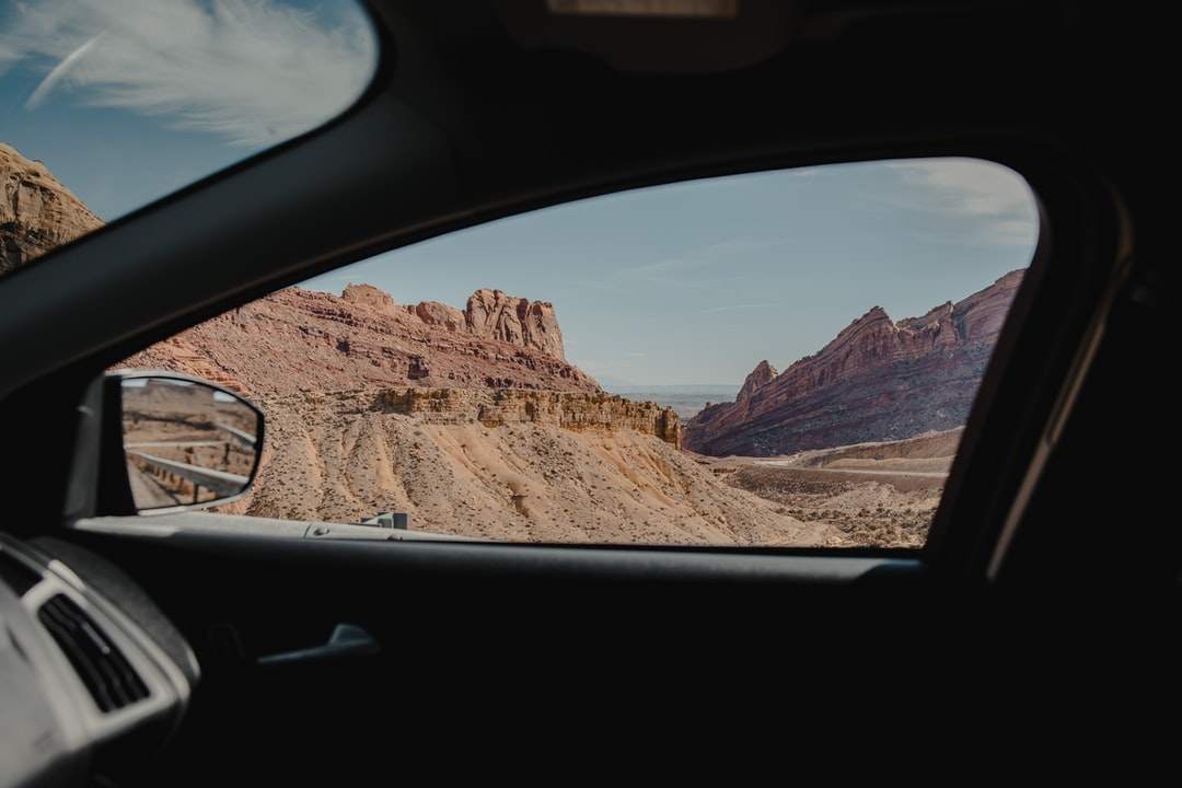 A side view mirror of a car window